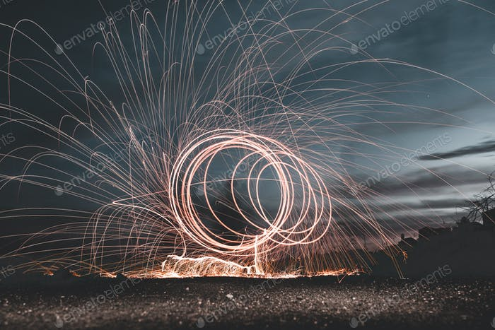 Abstract rounds above land at night