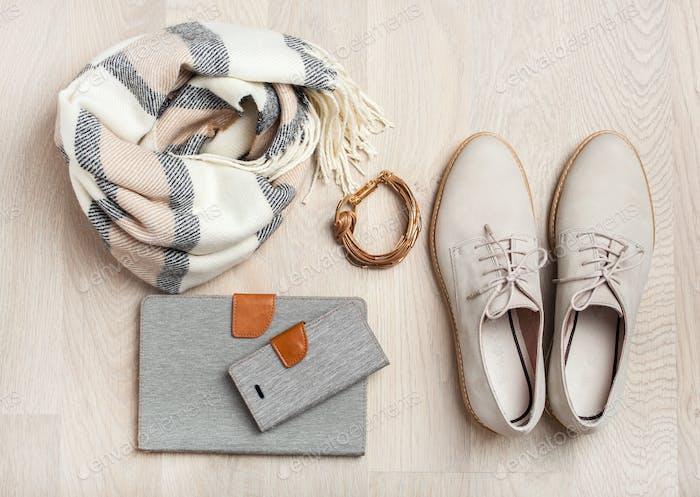 women's flat lay clothes shoes, scarf, bracelet, tablet, smartlp