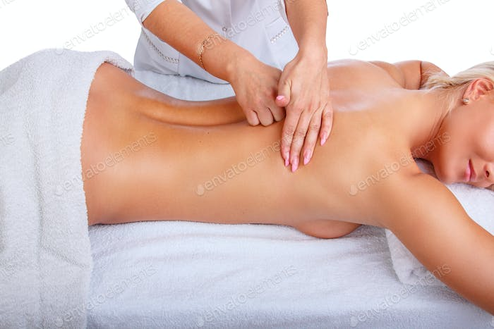 Female enjoing relaxing back massage.