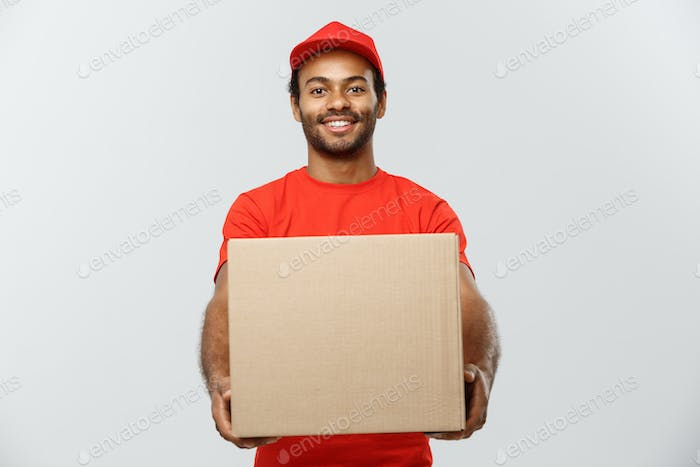 Delivery Concept - Portrait of Happy African American delivery man in red cloth holding a box