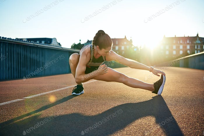 Sun highlights young muscular female athlete
