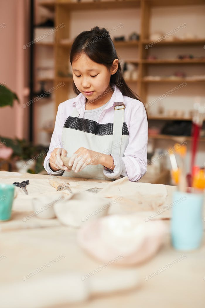 Asian Girl Enjoying Pottery Class