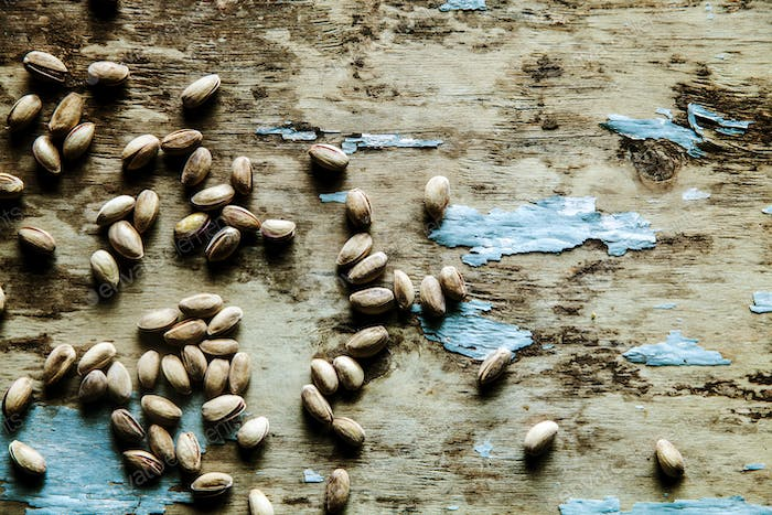 pistachios over slate background