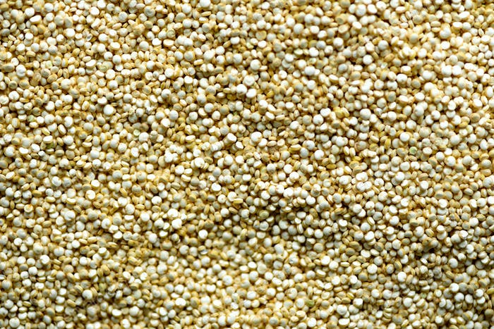 Raw organic quinoa grains background texture. Food ingredient background. Top view, healthy