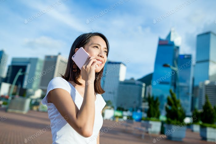 Woman talking to cellphone in Hong Kong