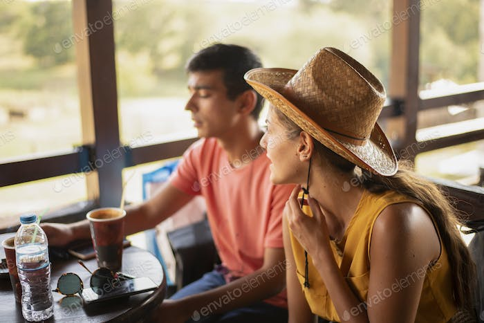 Friends Having a Coffee in a Ranch and Talking.