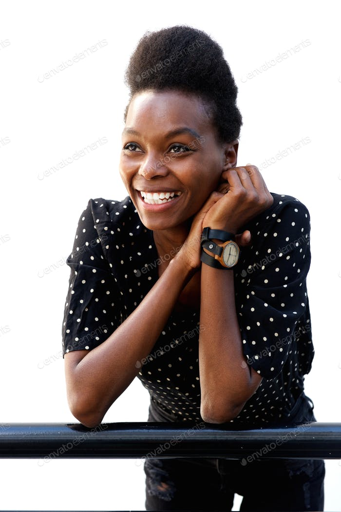 Beautiful young african lady leaning on railing and smiling