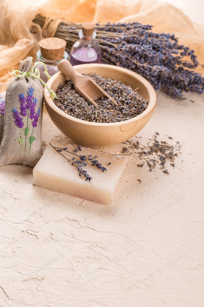 Wellness care products with lavender seeds in a bowl