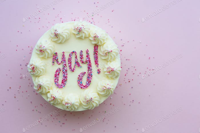 Birthday cake with yay written in sprinkles
