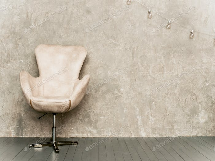 Home interior gray wall with beige velvet armchair