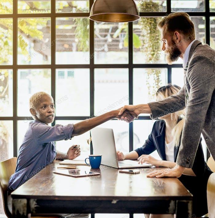Multiethnic Business Partners Handshake Deal Team Concept