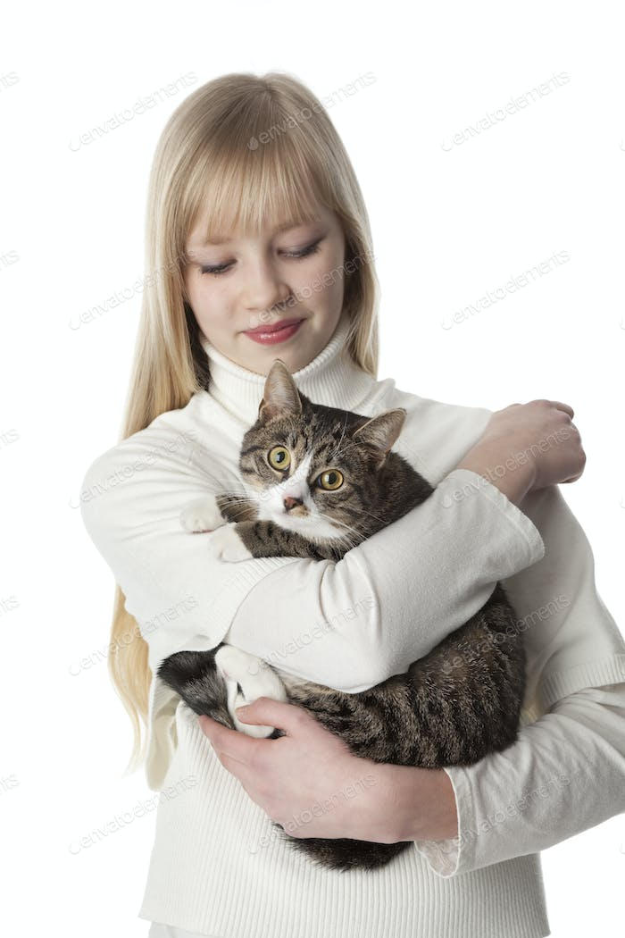 Portrait of a teenage gir with her pet cat