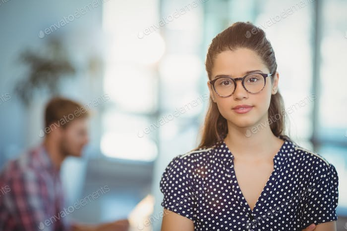 Portrait of female executive wearing spectacles