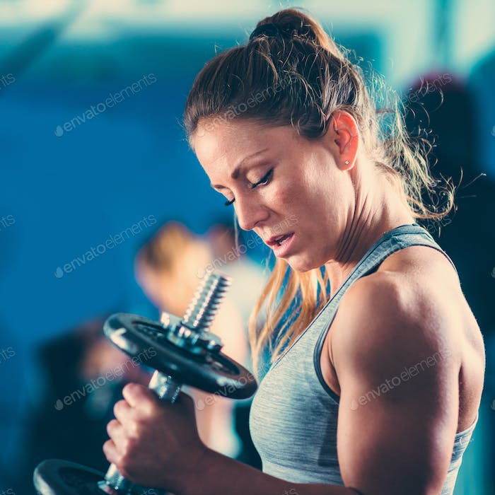 Sporty woman exercising in the gym
