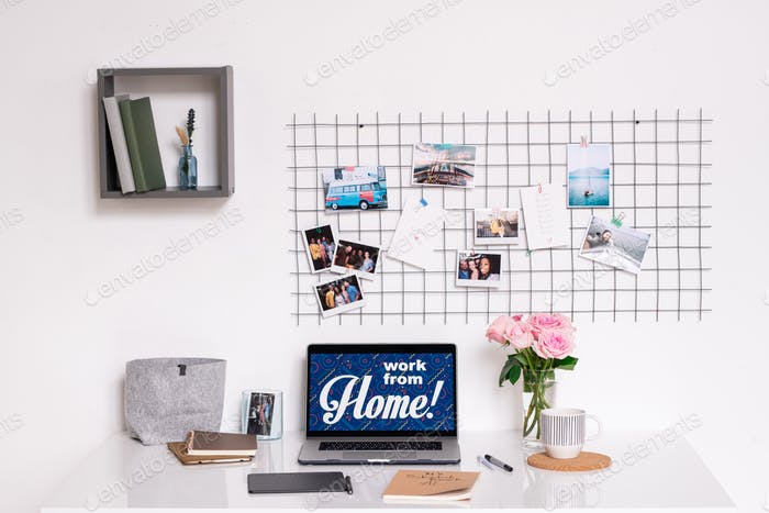 Workplace of contemporary designer by wall of domestic room or home office