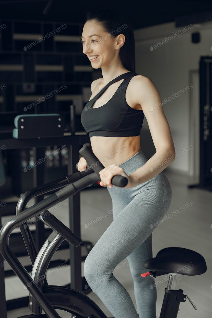 A beautiful girl is engaged in a gym