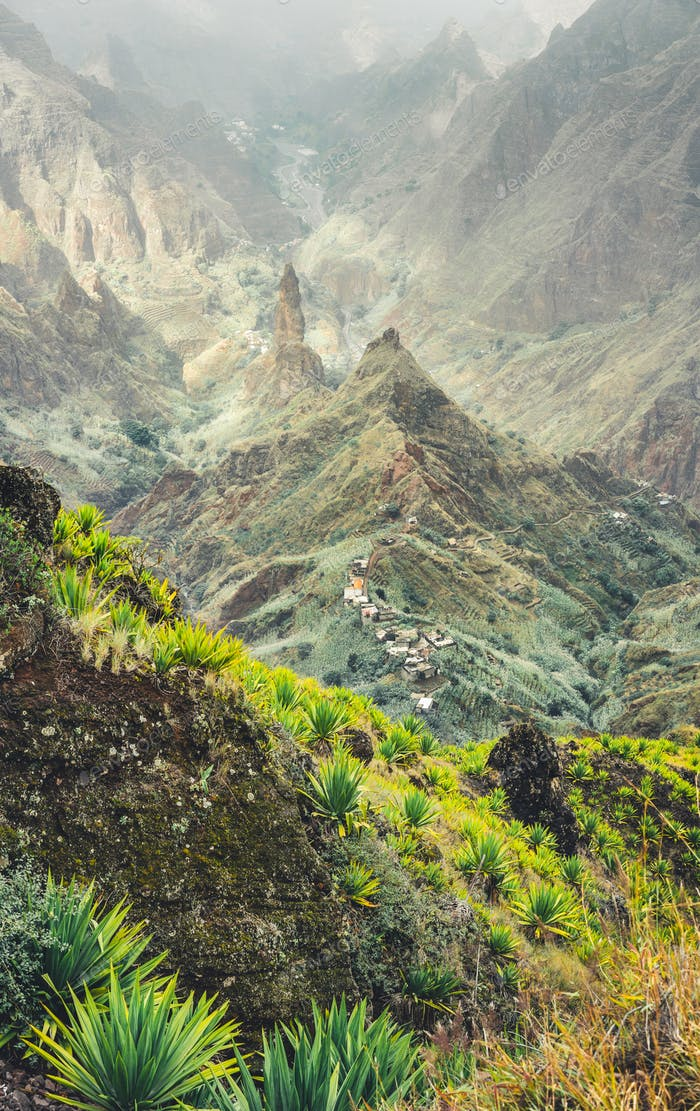 Mountain peaks of Xo-Xo valley in sun light. Local village in the valley. Many agava plants grow on
