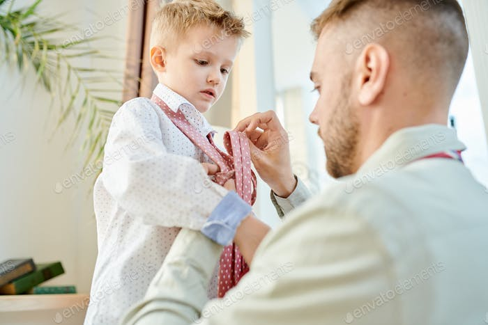Caring Father Dressing Up his Son