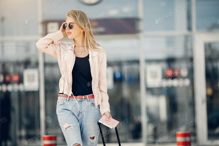 Beautiful girl standing in a airport