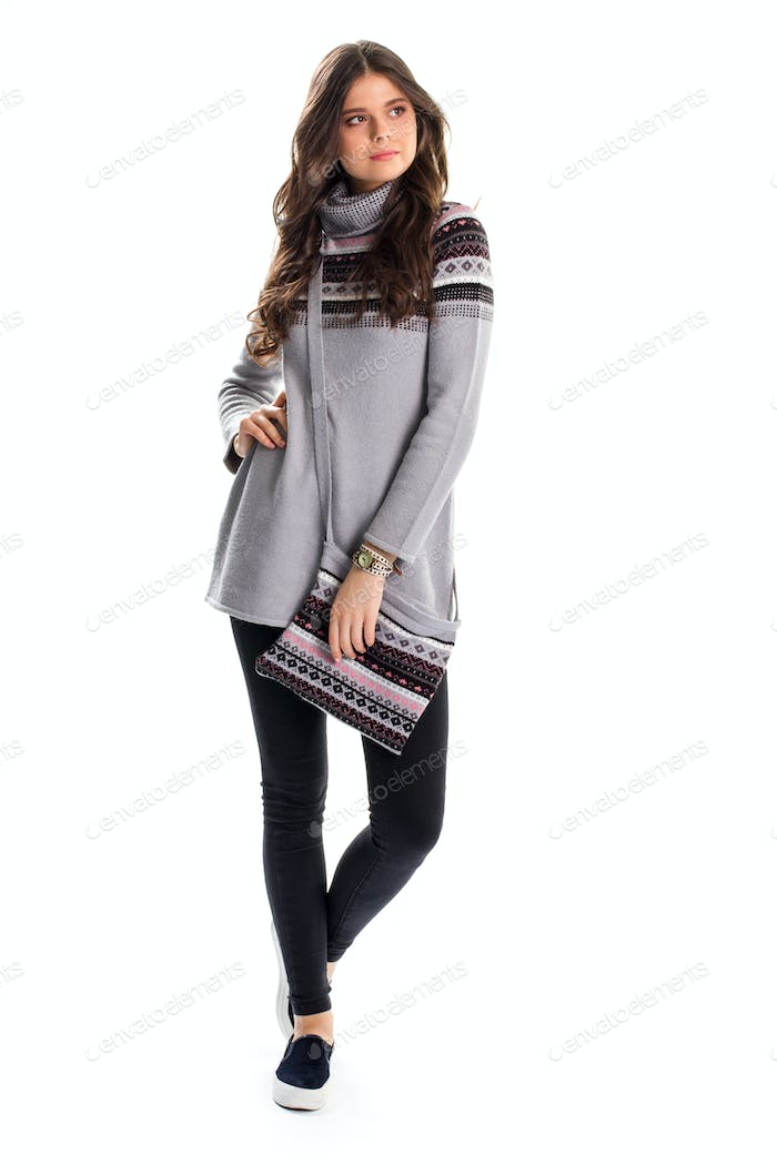 Lady in long gray pullover