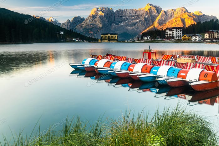 Beautiful Colorful Boats at Lake Misurina in Italian Dolomites a