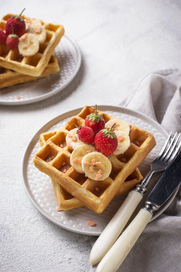Waffles with strawberries and banana