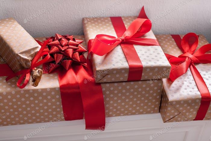 Elegant presents, gift boxes on white shelves background, closeup
