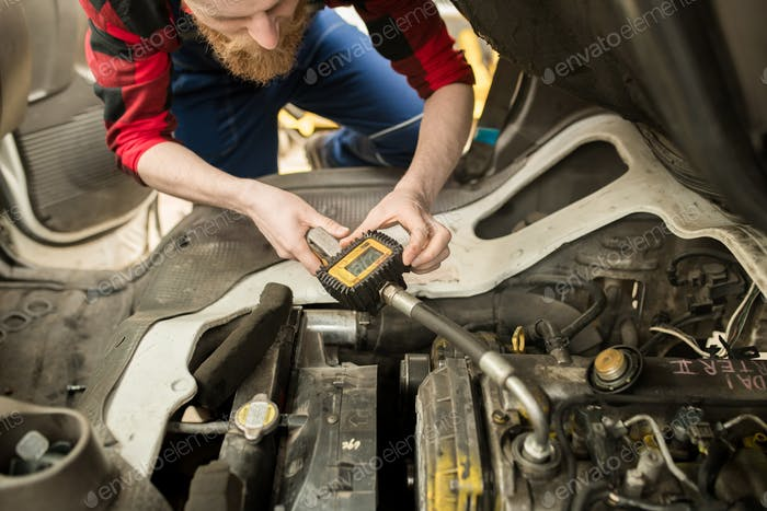 Auto Technician Checking Oil Level