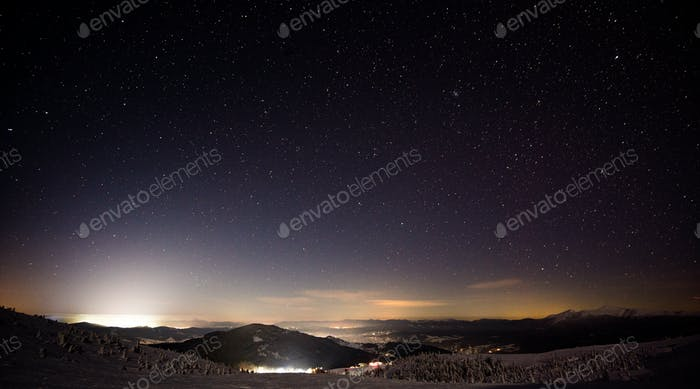 Night view of the ski resort with hills