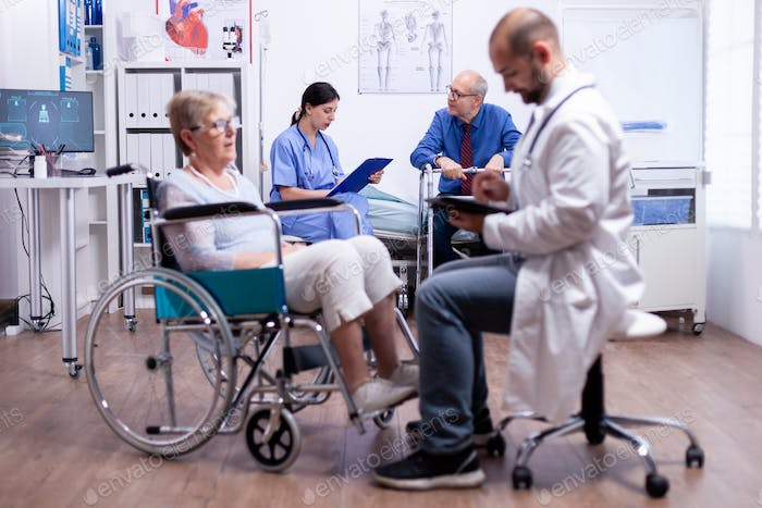 Nurse talking with disabled man