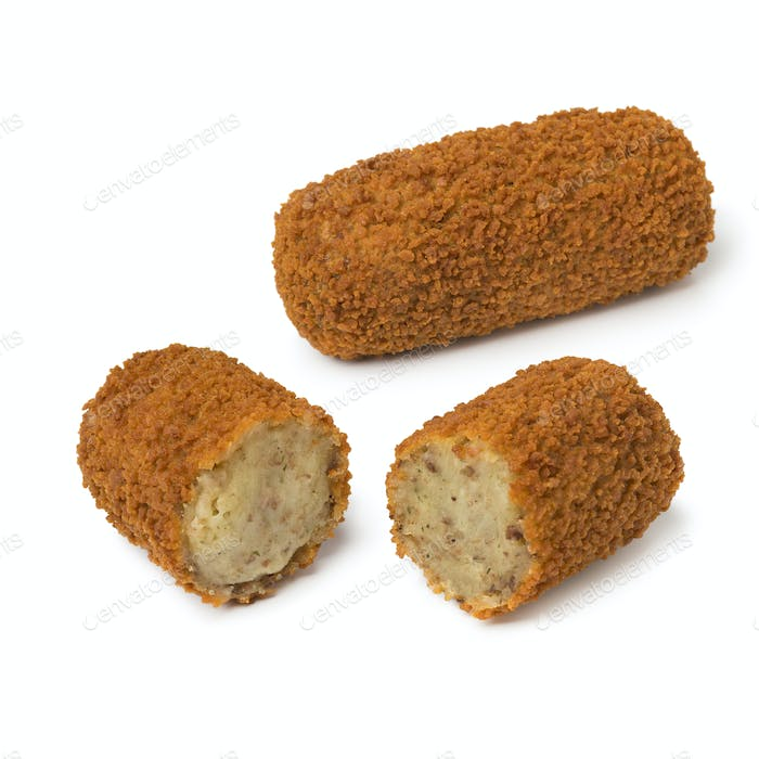 Single deep fried Dutch kroket and a sliced one