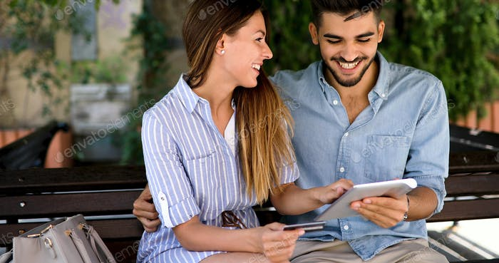 Couple in love shopping online using tablet