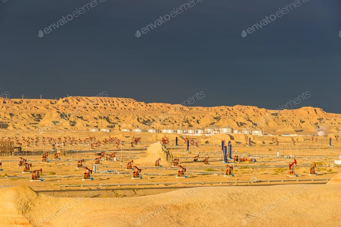 xinjiang windy city oil field in sunset