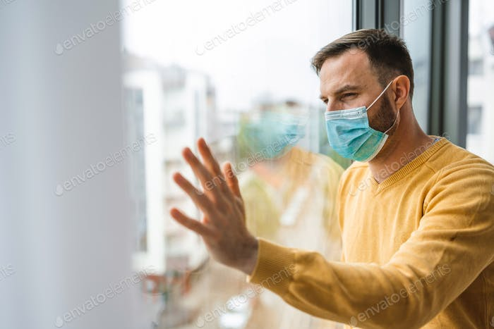 Man wearing medical face mask against the corona virus, covid-19. Quarantine, isolation concept