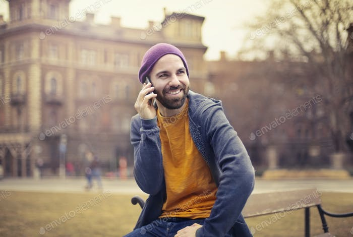 Man taking at the phone outdoor