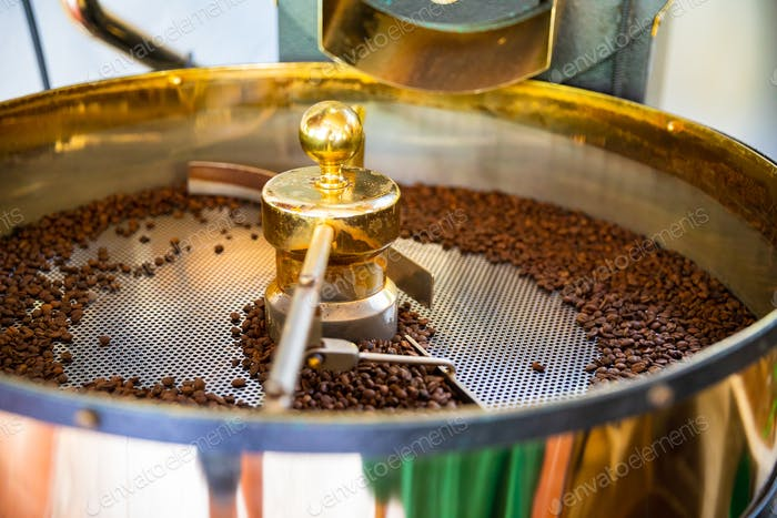 Raw Organic Coffee Beans Roasting In Machine