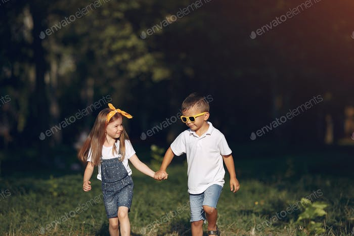 Cute little girl playing in a park with her friend