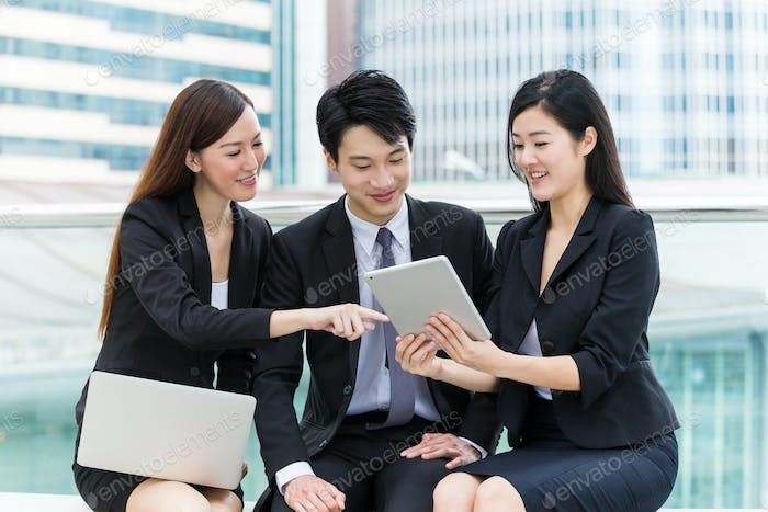 Business group of people using laptop computer and tablet computer