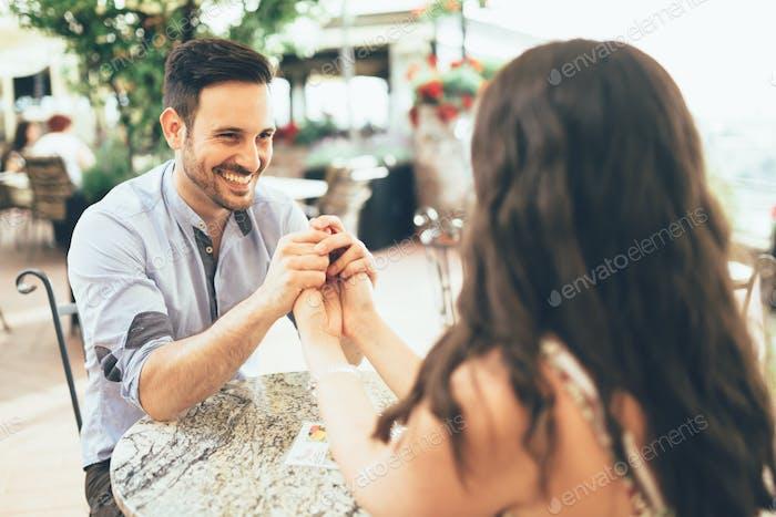 Romantic couple bonding in restaurant