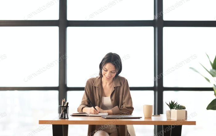 Portrait of girl taking notes at personal planner