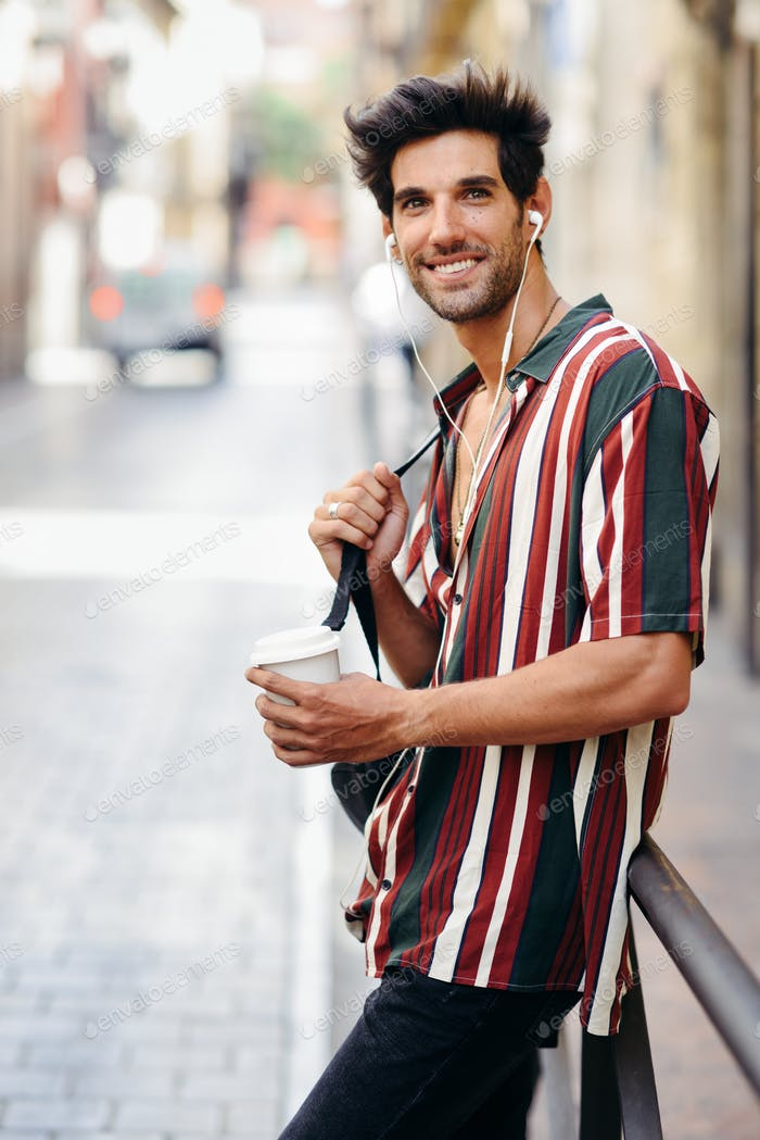Young male traveler enjoying the streets of Granada, Spain