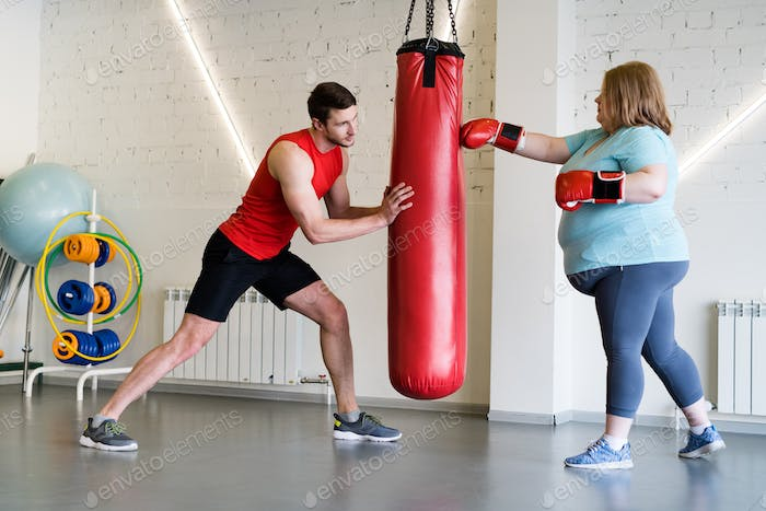 Overweight Woman in Boxing Training