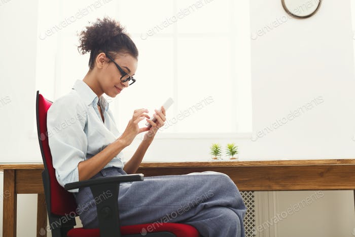 Business woman texting on smartphone