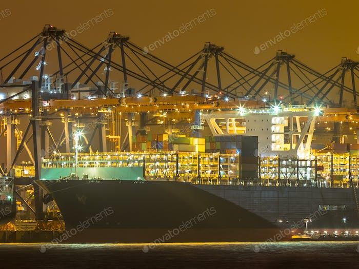 Prow of Cargo carrier ship at night