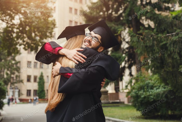 Pair of students hugging on their graduation day