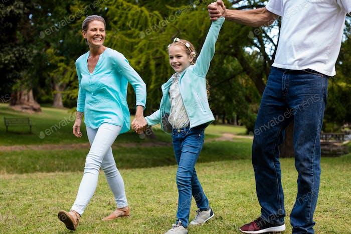 Happy family enjoying in a park