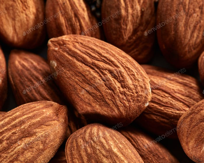 Organic texture of almonds. View from above. Almonds macro background. Almond nuts with soft focus