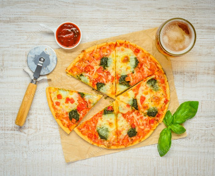 Sliced Pizza with Tomato Sauce and Glass Beer