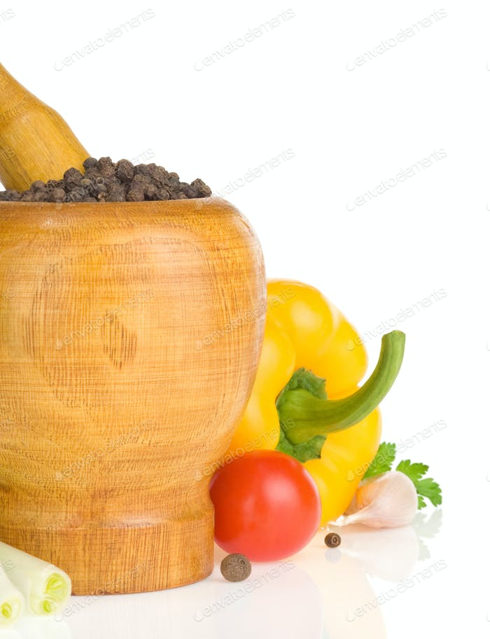 mortar with pestle and spices vegetable on white