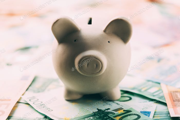 Piggy moneybox with euro cash